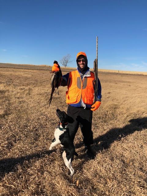 man holding a pheasant